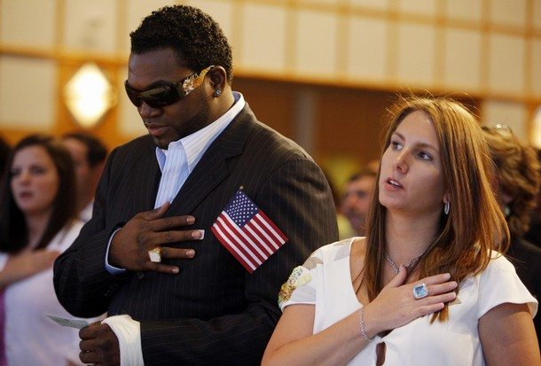 Boston Red Sox's Ortiz and his wife Tiffany recite the U.S. Pledge of Allegiance at a naturalization ceremony hosted at the John F. Kennedy Library in Boston