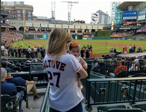 Nina Altuve and daughter watching Jose Altuve's Game